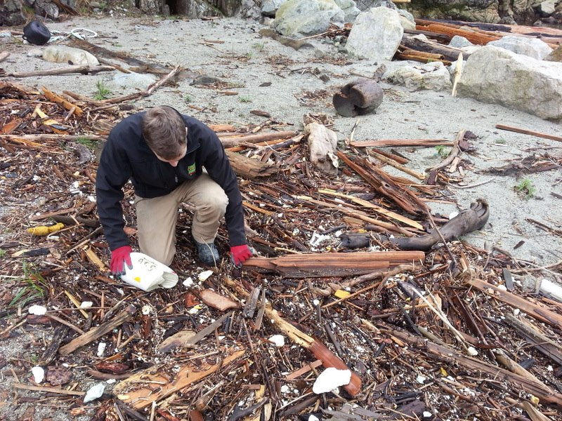 Duncan investigating the beach debris.  A sad reality of our oceans.