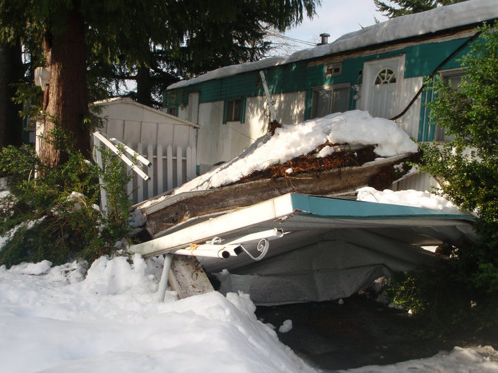 A New Westminster car port destroyed by snow