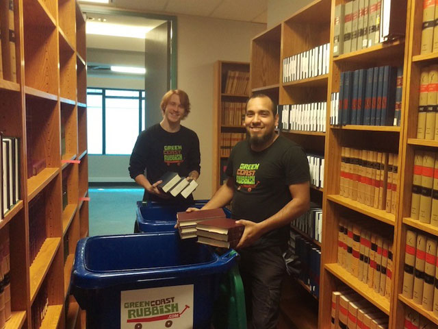 Sean and Karim doing book recycling in a library