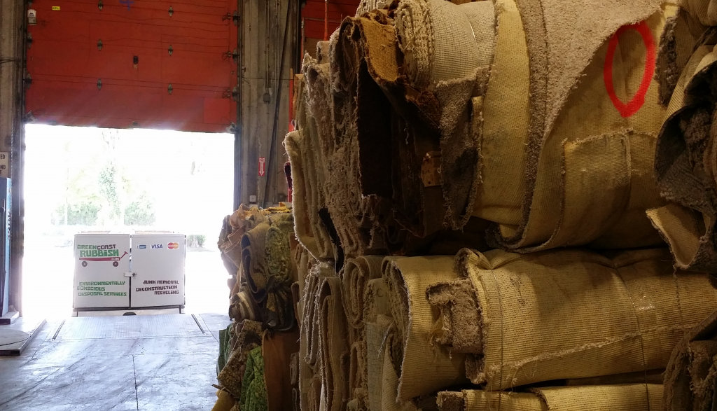 Nothing but carpet from floor to ceiling. Green Coast parked at the Pacific Carpet Recycling warehouse.