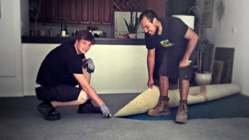 deconstruction services - the team ripping up carpet
