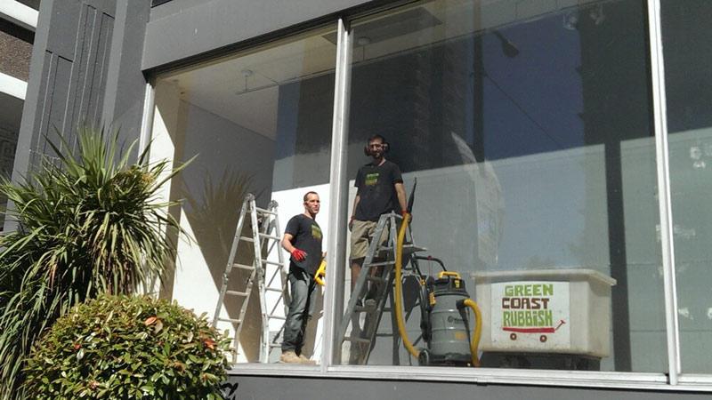 the green coast rubbish team deconstructing a building