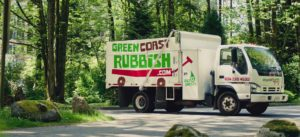 the green coast rubbish junk removal truck