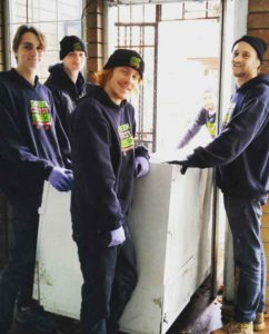 commercial junk removal services - freezer removal by team