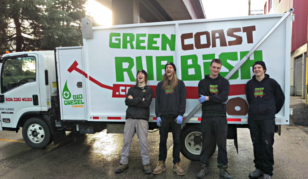 The team all smiles in front of our biodiesel truck on a commercial junk removal clean-out!